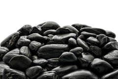 Pile of Black Polished River Stones Stock Image