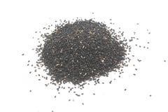 Pile of black sesame. Isolated on white background stock photography