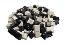 Pile of Black and White Computer Keyboard Keys. Stack of black computer keyboard keys on isolated white background Royalty Free Stock Image