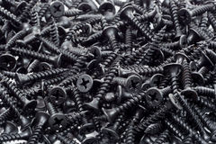 Pile of black wood screws Stock Image