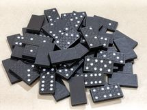 Pile of Black Wooden Domino Pieces Gathered royalty free stock photos