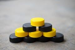 Black and yellow plastic bottle caps Stock Photos