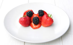 A pile of blackberries and strawbeeries Royalty Free Stock Images