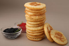 Pile of blini. And cup of lumpfish caviar royalty free stock photography