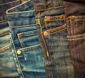 Pile of jeans. Pile of blue and black jeans. instagram image retro style Royalty Free Stock Image