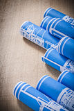 Pile of blue blueprint rolls on wooden board construction concep Stock Images