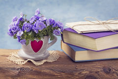 Pile of blue books. And campanula flowers Royalty Free Stock Photo
