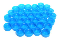 Pile of Blue Bottle Caps Royalty Free Stock Photography