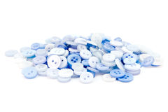 Pile of blue buttons over white Stock Photo