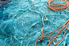 Pile of blue fishing nets Royalty Free Stock Photography
