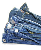Pile of blue jeans. Over white background Stock Photos
