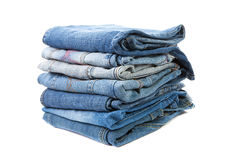 Pile of blue  jeans. Over white background Royalty Free Stock Images