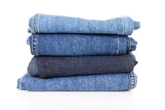 Pile of blue jeans. Over white background Royalty Free Stock Image
