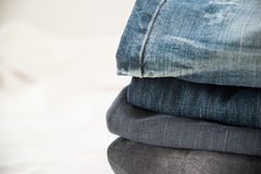 Pile of blue jeans close up Stock Photography