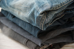 Pile of blue jeans close up Stock Photos
