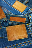 Pile of blue jeans closeup label Royalty Free Stock Photography