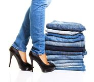 Pile of blue jeans. Isolated on white Royalty Free Stock Photos