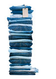 Pile of blue jeans isolated on white. Stock Image