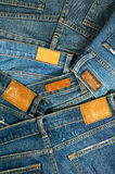 Pile of blue jeans with label Stock Image