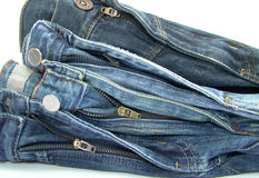 Pile of blue jeans pants. Pile of blue jeans over white background royalty free stock photos