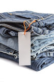 Pile of blue jeans with tag label. Royalty Free Stock Photo
