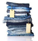 Pile of blue jeans with tags Stock Photo