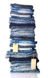Pile of blue jeans with tags Royalty Free Stock Image