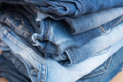 Pile of blue jeans trousers. In a shop Royalty Free Stock Image