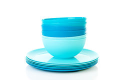 Pile of blue plastic plates and bowls. Over white background Stock Images