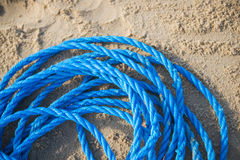 Pile of blue rope on the sand Stock Image