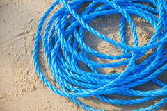 Pile of blue rope on the sand Royalty Free Stock Images