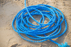 Pile of blue rope on the sand Stock Photos