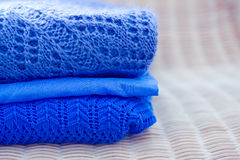 Pile of blue tops, clothes and fashion series Royalty Free Stock Photography