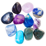 Pile of blue and violet natural mineral gemstones Stock Photos