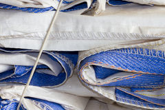 Bulk Seed Bags. Pile of Blue and White Folded Bulk Seed Bags with exposed stiching royalty free stock photo
