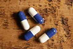 Pile of blue and white pills Stock Images