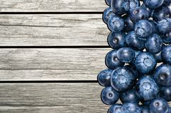 Blueberries on the table made of wooden boards Stock Photo