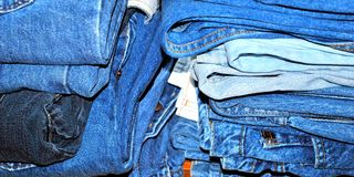 Pile of bluejeans stacked. Pile of bluejeans stacked to give away to charity stock photography