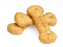 Pile of bone-shaped dog biscuits Royalty Free Stock Image