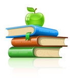 Pile book with green apple Royalty Free Stock Image