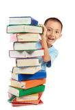 Pile of book with lovely kid behind it Stock Images