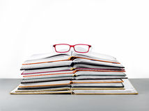 Pile of book and red glasses stock images
