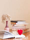 Pile of book with withered flowers Stock Photo