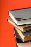 Pile of books. Pile of old books against a red background Royalty Free Stock Image