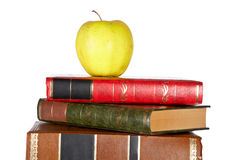Pile of books. Apple on the pile of books isolated isolated on white background stock image