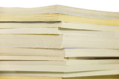Pile of books. In a soft cover. On a white background Stock Photo