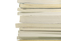 Pile of books. In a soft cover. On a white background Royalty Free Stock Photo