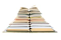 Pile of books. Isolated on white, looks like a pyramid Stock Images