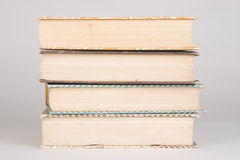 Pile of Books. Four vintage books piled and stacked on top of each other Stock Photos