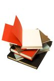 Pile of books. A pile of books with the top one open isolated against a white background Royalty Free Stock Image
